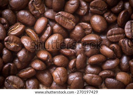 roasted coffee beans close up background.