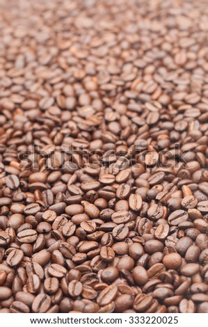 Roasted coffee beans for background or texture; Coffee - one of the most important trading goods in the world - stock photo