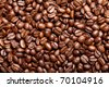 roasted coffee beans forming a background pattern - stock photo