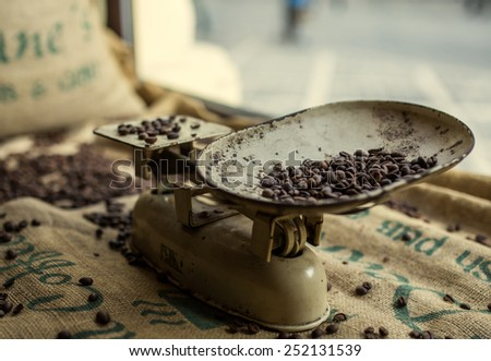 Roasted coffee beans in a scale - stock photo