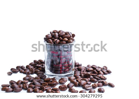 Roasted coffee beans in coffee shot glass - stock photo