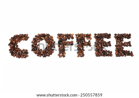 Roasted coffee beans in shape of alphabets, coffee - stock photo