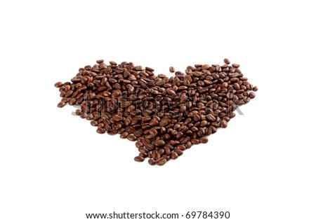 roasted coffee beans in the shape of the heart on white background
