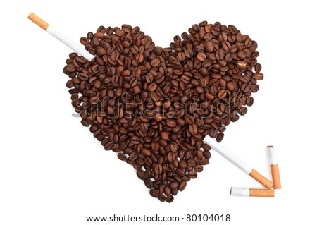 Roasted coffee beans in the shape of the heart with cigarettes isolated on a white background - stock photo