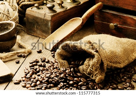 Roasted coffee beans in vintage setting - stock photo