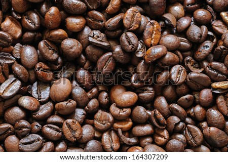 Roasted coffee beans look like a background - stock photo