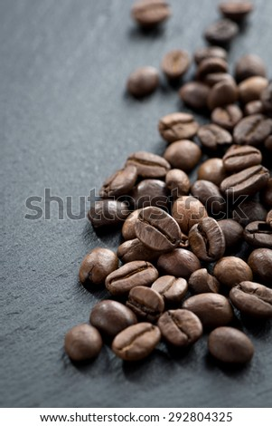 roasted coffee beans on a dark background, vertical, top view - stock photo