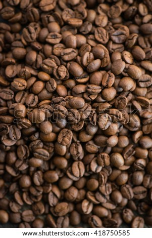 Roasted coffee beans on a rustic wooden table