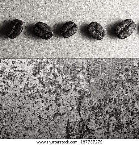Roasted Coffee Beans on paper and concrete texture, monotone color