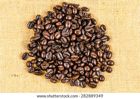 roasted coffee beans on sack cloth