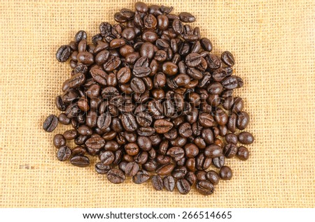 roasted coffee beans on sack cloth background