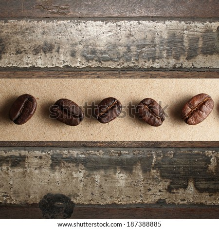 Roasted Coffee Beans on wood and concrete texture - stock photo