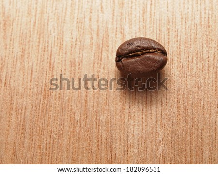 Roasted Coffee Beans on wood texture table - stock photo