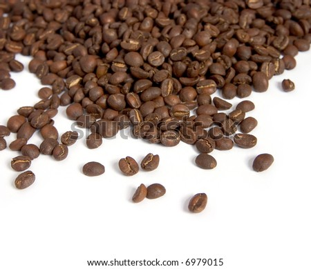 Roasted coffee beans spread out on a pure white background