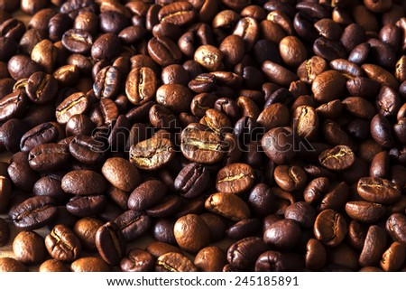 roasted coffee beans, used as a background - stock photo