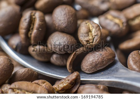 Roasted coffee beans with silver spoon