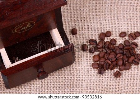 Roasted coffee beans with wooden Coffee grinder - stock photo