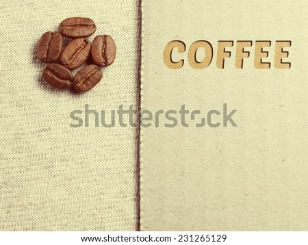 Roasted Coffee crop beans on fabric textile, vintage color background