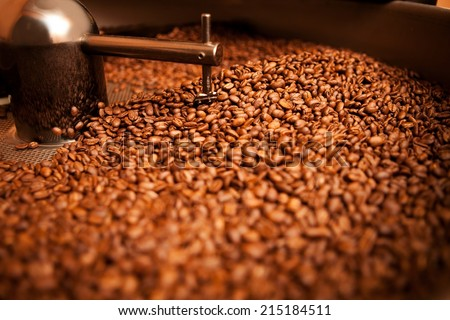 roasted coffee in roaster - stock photo