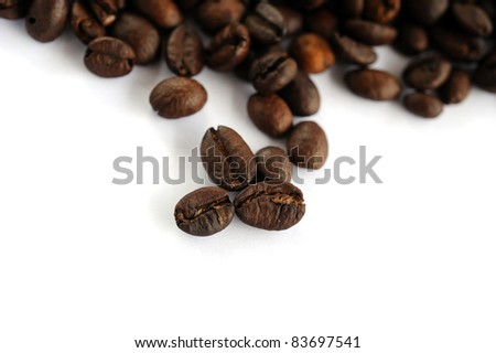 Roasted coffee isolated on a white background, selective focus.