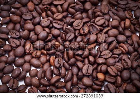 Roasted Coffee Seed Background Closeup - stock photo