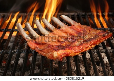 Roasted Country Style Baby Back Or Spare Ribs On The Hot Flaming BBQ Grill, Close-up - stock photo
