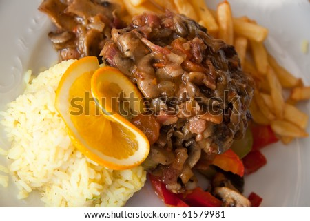roasted cutlet of veal with mushrooms and french fries