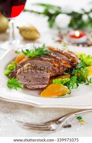 Roasted duck breast with salad for Christmas dinner, selective focus - stock photo