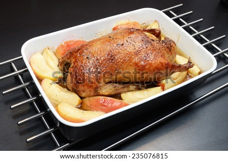 Roasted duck, stuffed with apples and honey.
