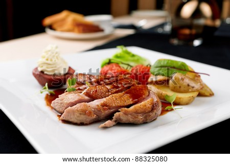 Roasted duck with pear,marinated in red wine and mascarpone rose - stock photo