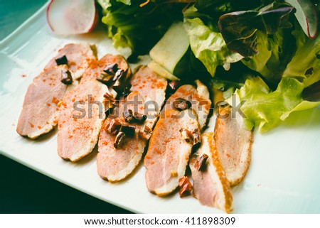 Roasted duck with pear,marinated in red wine and mascarpone rose - vintage tone. - stock photo