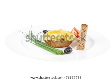 roasted fish fillet with tomatoes,chives and bread on plate over white plate - stock photo