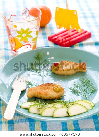 Roasted fish  with fresh cucumber for child's dinner