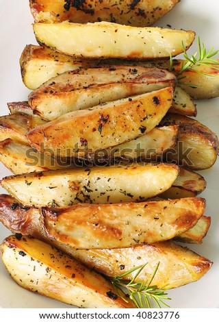 roasted garlic potatoes vertical upclose - stock photo