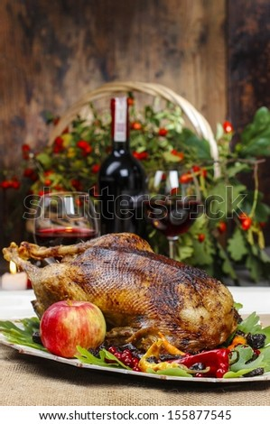 Roasted goose in autumn setting - stock photo