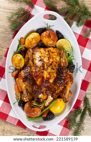 Roasted Holiday Chicken With Potatoes and Apples - stock photo