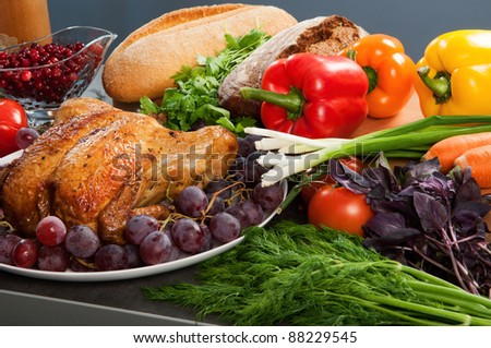 Roasted holiday turkey garnished with sourdough stuffing and fruit - stock photo
