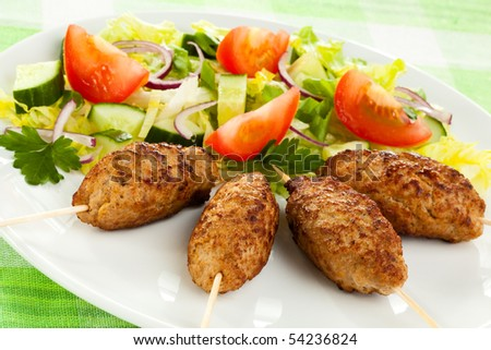 Roasted kebab with vegetables - stock photo