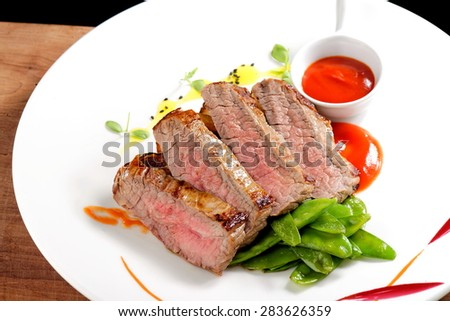 Roasted Kobe Marbled beef fillets with snow peas and tomato sauce