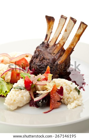 Roasted Lamb Chops with Risotto and Vegetables. Garnished with Sauce - stock photo