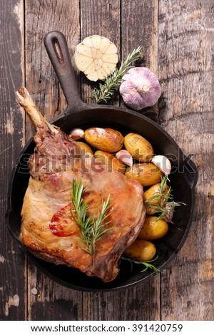 roasted lamb leg and potato - stock photo