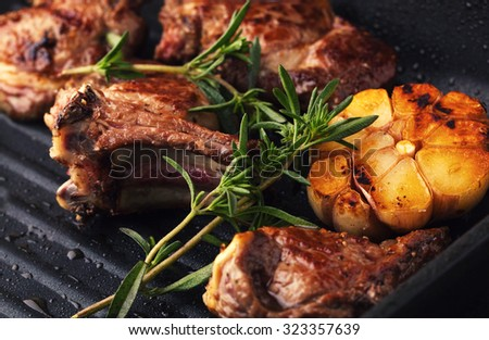 Roasted lamb ribs with spices and garlic - stock photo