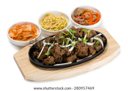 Roasted lamb with onions in a skillet and salads heh. From a series of Food Korean cuisine. - stock photo