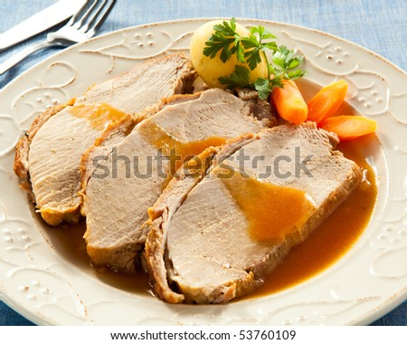 Roasted loin slices with vegetables - stock photo