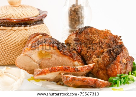 roasted meat on a plate with spices