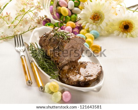 roasted meat over easter table - stock photo