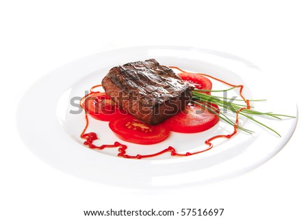 roasted meat served with tomato on ceramic plate