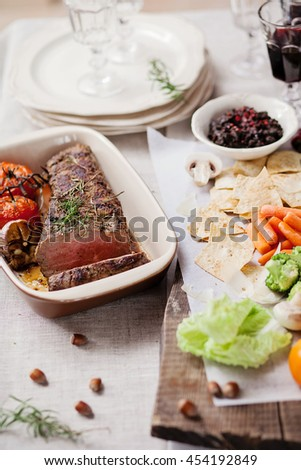 roasted meat served with vegetables