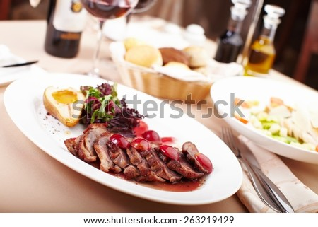 Roasted meat slices on a plate late dinner - stock photo