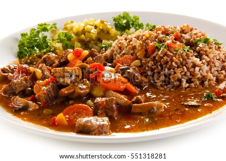 Roasted meat, white grits and vegetables